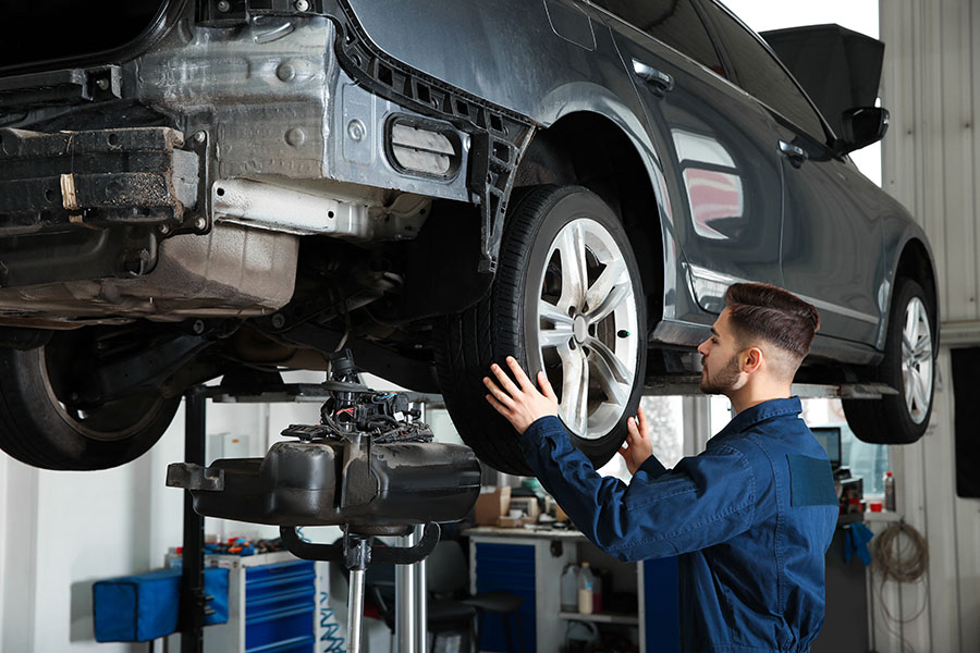 Specialized Business Insurance - Auto Mechanic Working on a Car in Garage Repair Shop